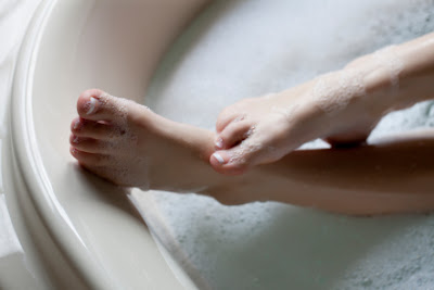 female feet in bathtub
