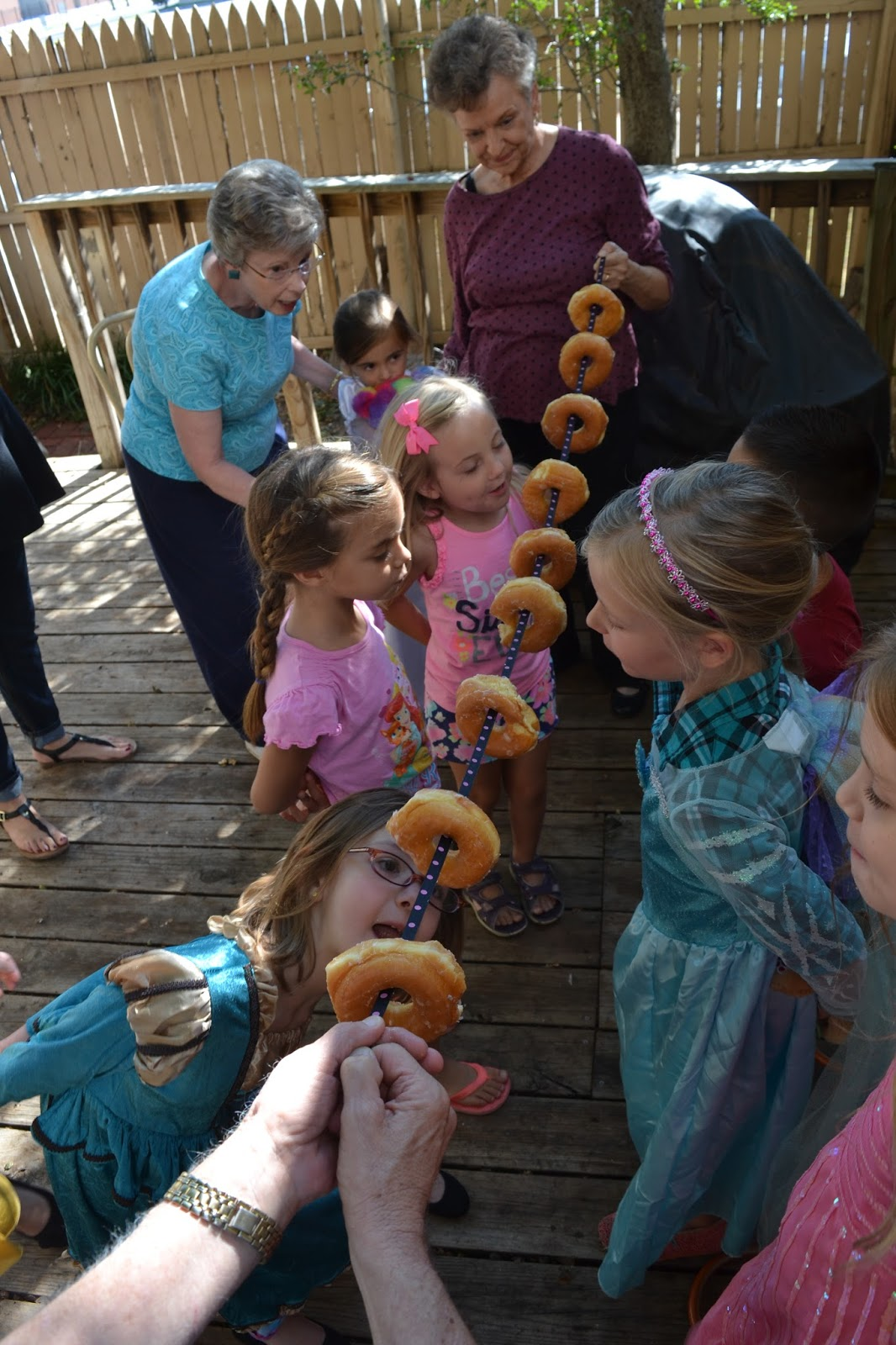 i highly recommend this donut game for your next party it works for people of all ages just put donuts on a string and have them try to eat them without