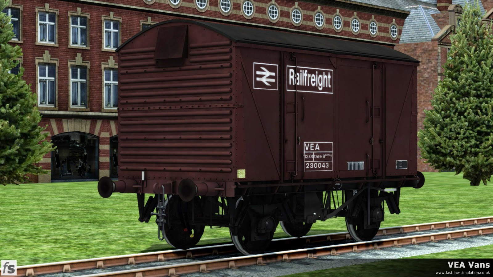 Fastline Simulation - VEA Vans: A recently converted VEA van sits outside the works in maroon livery. Although well known for carrying Railfreight flame red and grey livery the first fifty or so VEA vans were turned out in maroon.