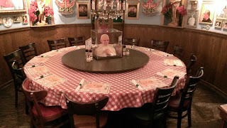 circular table at italian restaurant with pope head in middle