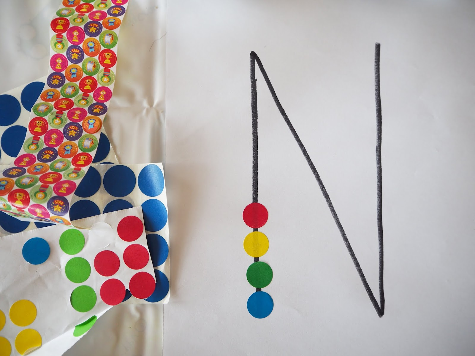 learn with play at home  fine motor dot sticker letter