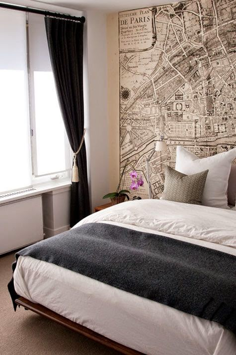repurposed black and white vintage map as headboard