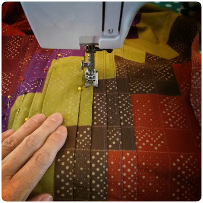 Carefully stitching pleats...