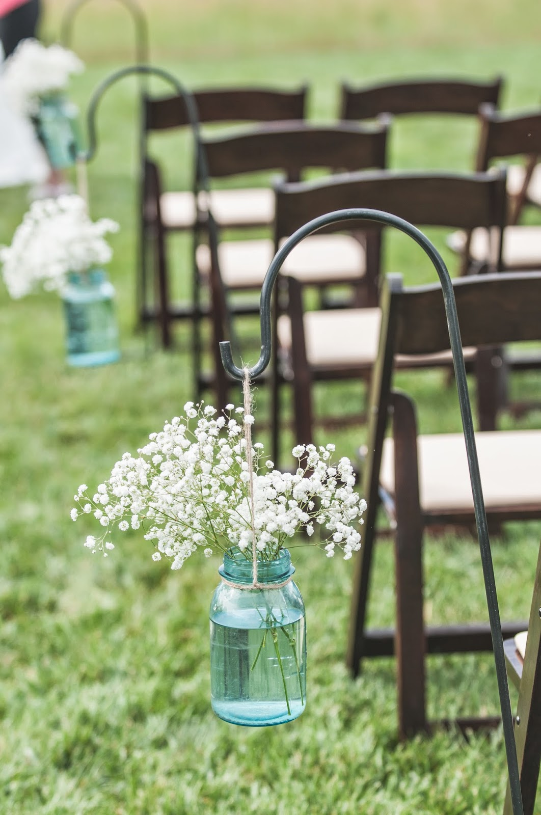 shepherd hook baby's breath for aisle liner in outdoor wedding ceremony