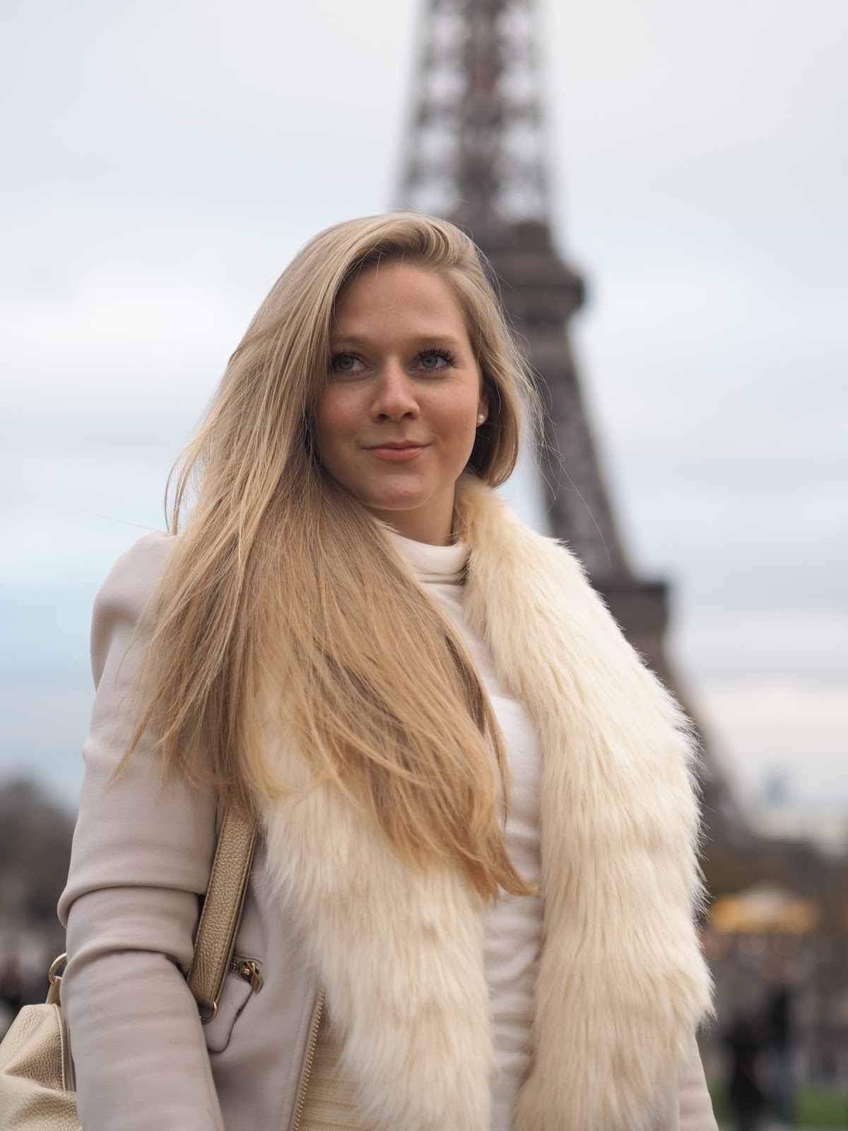 Blonde Girl, Katie Matthews, KALANCHOE, standing outside the Eiffel Tower, Paris