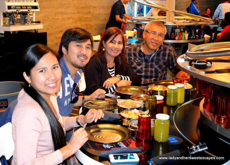 family at Rogo's the roller coaster restaurant