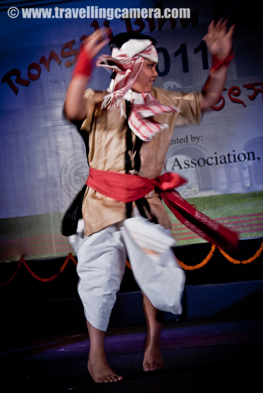 Rogali Bihu Festival 2011 by Assam Association, Delhi @ Indira Gandhi National Center of Arts, New Delhi, INDIA : Posted by VJ SHARMA on www.travellingcamera.com : 'Assam Association, Delhi' celebrated Rongali Bihu Festival on 24th April 2011 at Indira Gandhi National Center of Arts (IGNCA) on Ranjendra Prasaad Road near Central Secretariate Metro Station in Delhi !! This event took place during the lovely evening on Sunday in the presence of a huge audience in traditional getups. The attendance was large by Delhi standards and I am totally fan of Assamese Culture !!! Check out these Photographs from RONGALI BIHU FESTIVAL 2011 ....On Sunday morning I was chatting with one of my friend on Facbook and she told me about this event !! Although it was a lazy Sunday for me but I thought of not missing this opportunity to get out of the house and feel the heat of Delhi :)  I also took two office friends along and had a great evening !! This event continued till 11:00 pm but we had to leave early. That was a sad parfor us, as no one of us wanted to leave the place...Bohag Bihu is the national festival of Assamese as it marks the beginning of the New Year (Nava Varsha !!!). Rituals and customary practices of Bohag Bihu starts from April 13 of year. There are three forms of a Bihu festival namely Bohag Bihu or Rongali Bihu (in the middle of April), Magh Bihu or Bhogali Bihu (middle of January) and Kaati Bihu or Kongali Bihu (in October/ November). To start the program, a group of Assam association came and sang a beautiful song in their local language... It seems that song they sung was very significant and has good impact on Assamese culture !!!Rongali Bihu (Bohag Bihu) is the most important day of all the three Bihu festivals. This day begins with the sowing of seeds, Kaati Bihu marks the complete process of sowing and transplanting of paddies, and the Magh Bihu marks the end of the harvesting period.Here is the lady who managed the stage with another gentleman !!! I really loved the dressup of all the men and women thir... beutiful Saaris and kurtas !! No words to explain the uniqueness and the impressions of strong culture !!!It's just the beginning ! I was hoping some hip-hop :) ... But whole evening was packed with  various versions of Bihu Dance performances... I was asked to wait till the end for actual and the BIG Bihu performance, but I had no option :(The Bihu dance  is a folk dance from the Indian state of Assam related to the festival of Bihu. This joyous dance is performed by both young men and women and is characterized by brisk dance steps and rapid hand movement. Dancers wear traditionally colorful Assamese clothing and this adds more value to overall performance !!! Huchori - Huchori is an integral part of Rongali Bihu. Choral parties of singers and dancers moving from house to house is a salient feature of Rongali Bihu !!!A group of boys performed Hichuri on the stage and it was really interesting to see overall getup of folks in the groups and it seems elder folks also join this group to better guide theyounger ones :) .. Although I was not able to make any sense out of the songs or dialogs, but it looked very interesting !!!The word Bihu is derived from the language of the Dimasa Kacharis... Their supreme god is Brai Shibrai or Father Shibrai. The First crops of the season are offered to Brai Shibrai while wishing for peace and prosperity. So Bi means