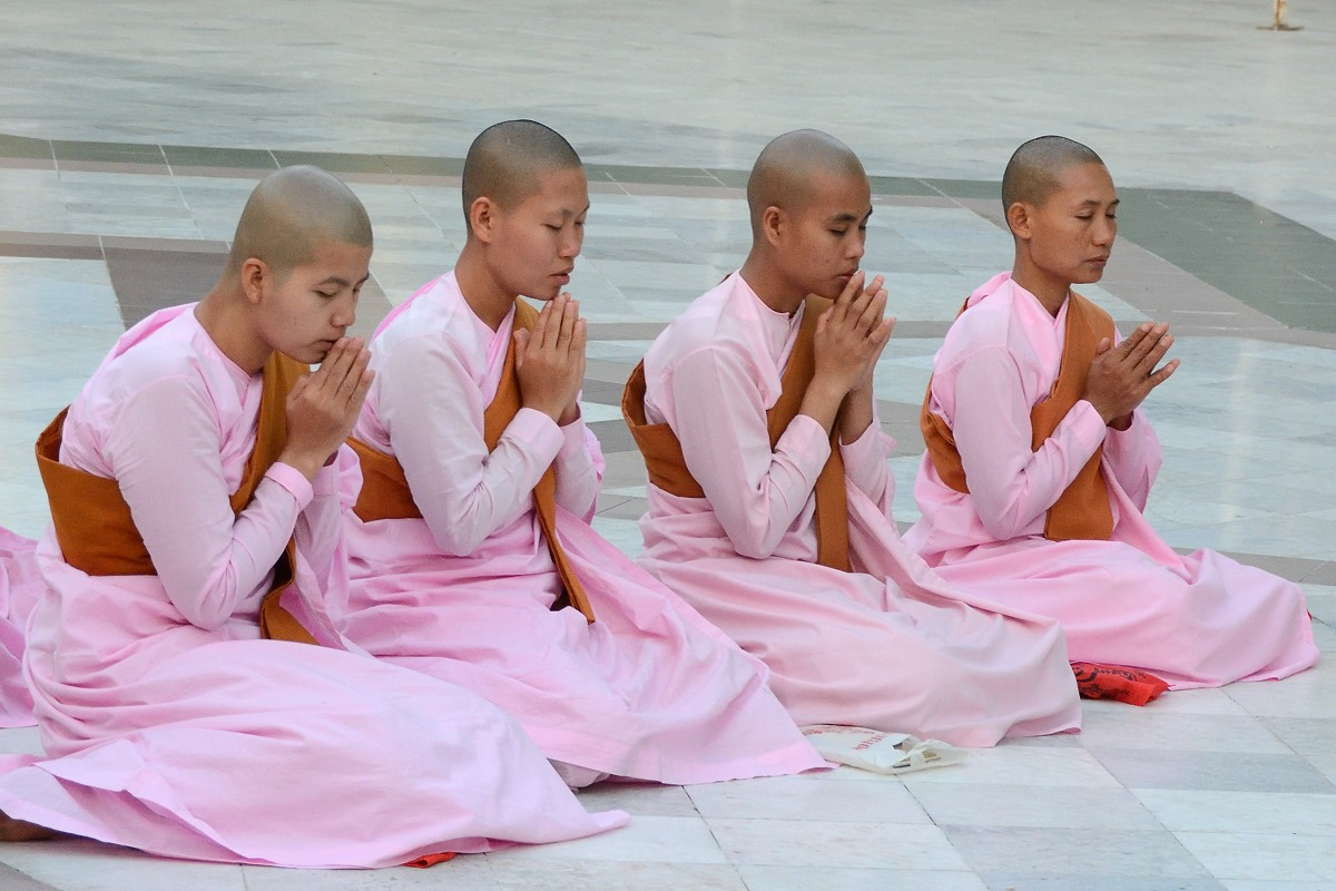 Buddhist nuns praying at Shwedagon Pagoda in Yangon