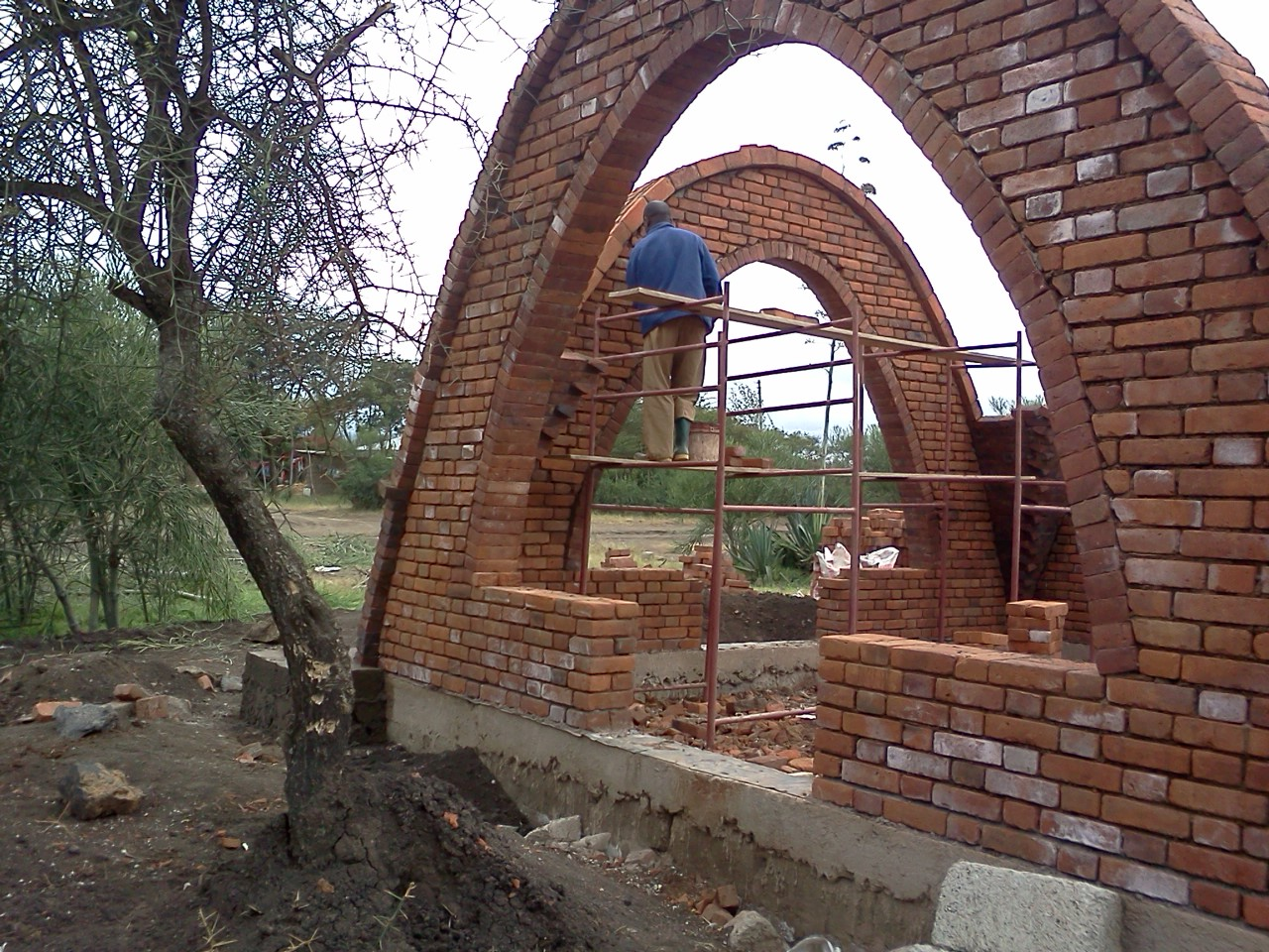 Alternative building construction in tanzania june 2012 for Brick house construction