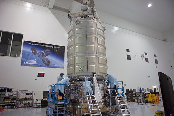 The Cygnus Pressurized Cargo Module (PCM) and Service Module (SM) are mated at Kennedy Space Center after the initial cargo bound for the space station was loaded into the PCM. Credit: NASA