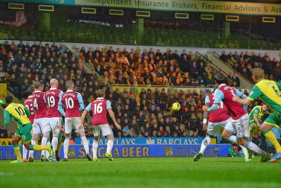 Norwich player Robert Snodgrass scores his side's second goal against West Ham from a free-kick