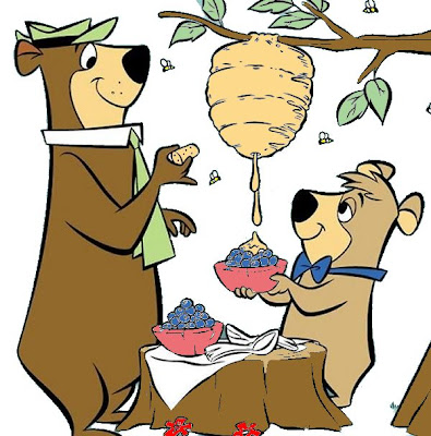 Yogi Bear and Boo Boo putting honey on their berries