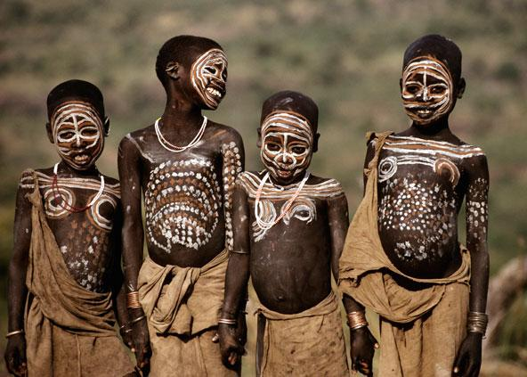 four boys with aboriginal tribal body paint