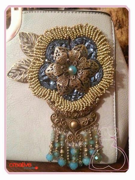 Detalle decorativo del bolso de mano hecho con cápsulas de Nespresso por Sylvia Lopez Morant