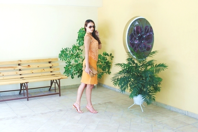 Monochromatic look   Sophisticated Orange.Claire orange pencil skirt.Embellished sheer orange top.Shooz leather snakeskin sandals.Ray Ban Aviator light brown sunglasses.