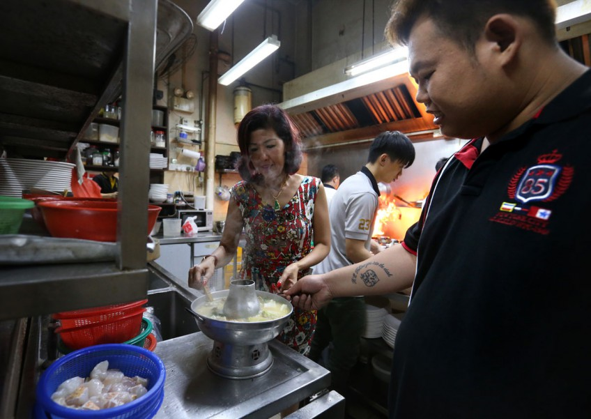 Chef Lok Wei Qiang (far right) was turned down by nine other employers before he was hired by Ms Guan, who owns Whampoa Keng Fish Head Steamboat at Rangoon Road.