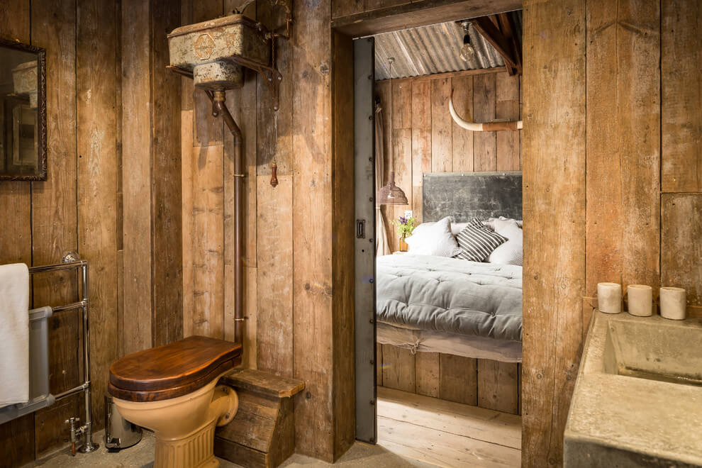 Caba a de madera decorada con estilo r stico - Pinturas para madera interior ...