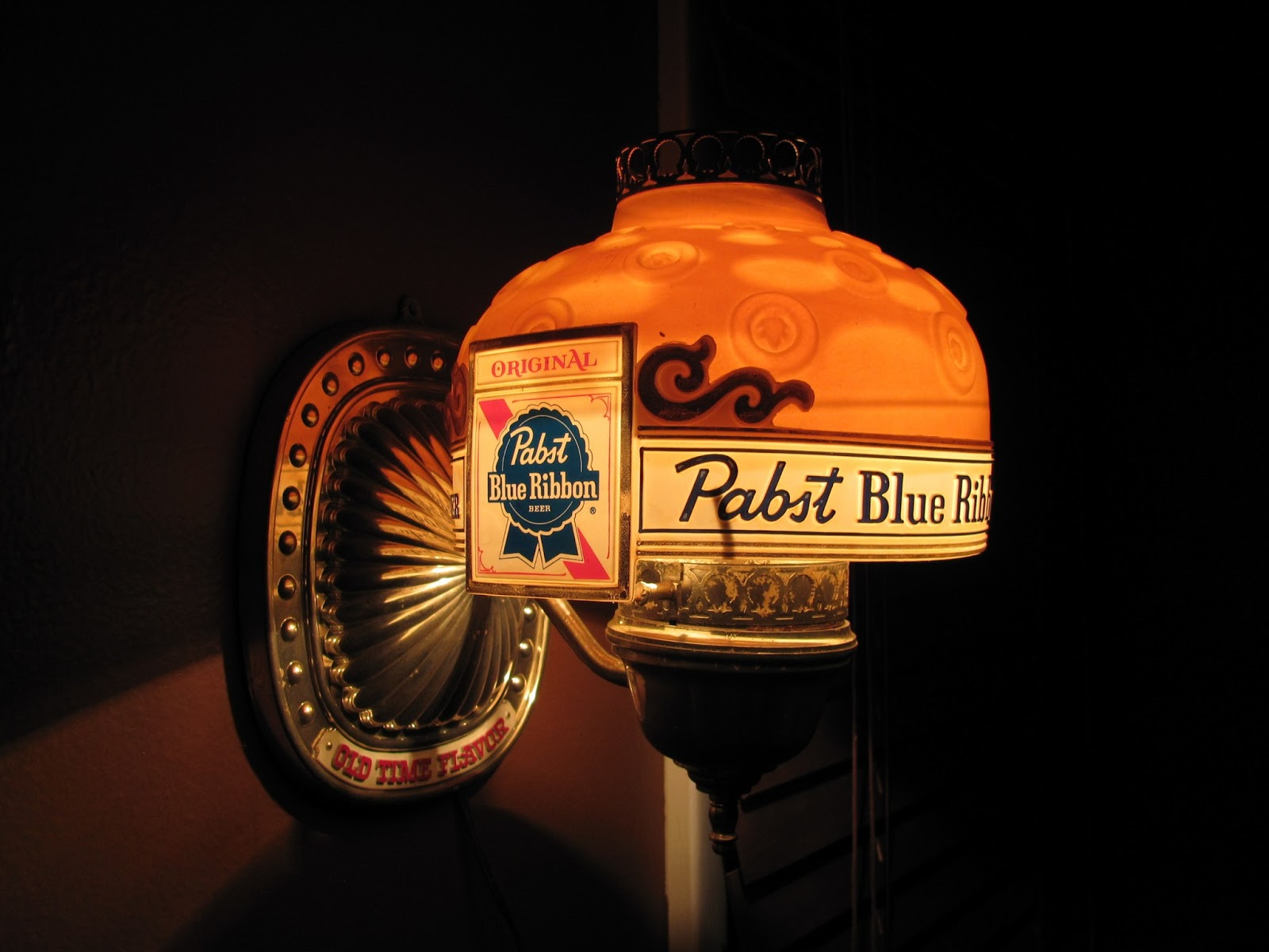 PBR wall light on display in action in a dark room