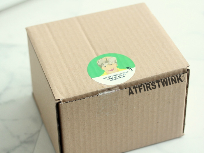 Lush carton box with sticker drawing of the one that packed it