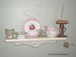 mosaic shelf , vintage saucer picture frame