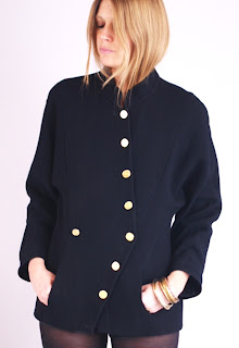 Vintage 1980's Chanel black jacket with gold hardware and front button closure.