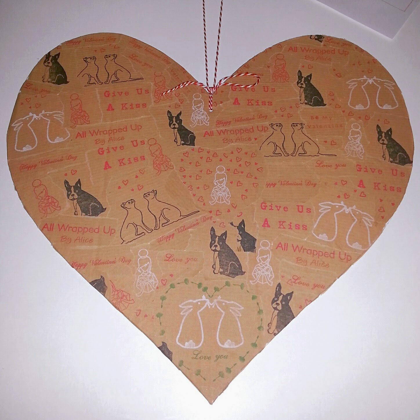 http://www.wrappedbyalice.co.uk/blog/4587767085/DIY-Decoupage-Heart/9393860