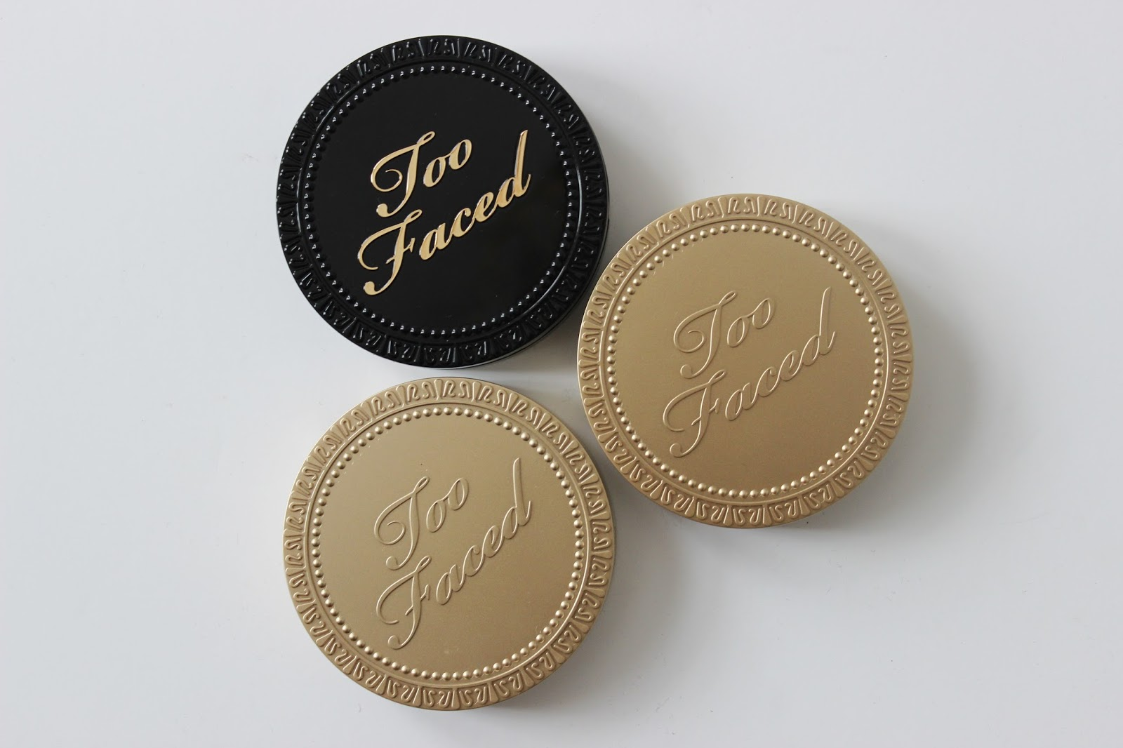 Too Faced cocoa powder foundation and soleil chocolate bronzers compacts