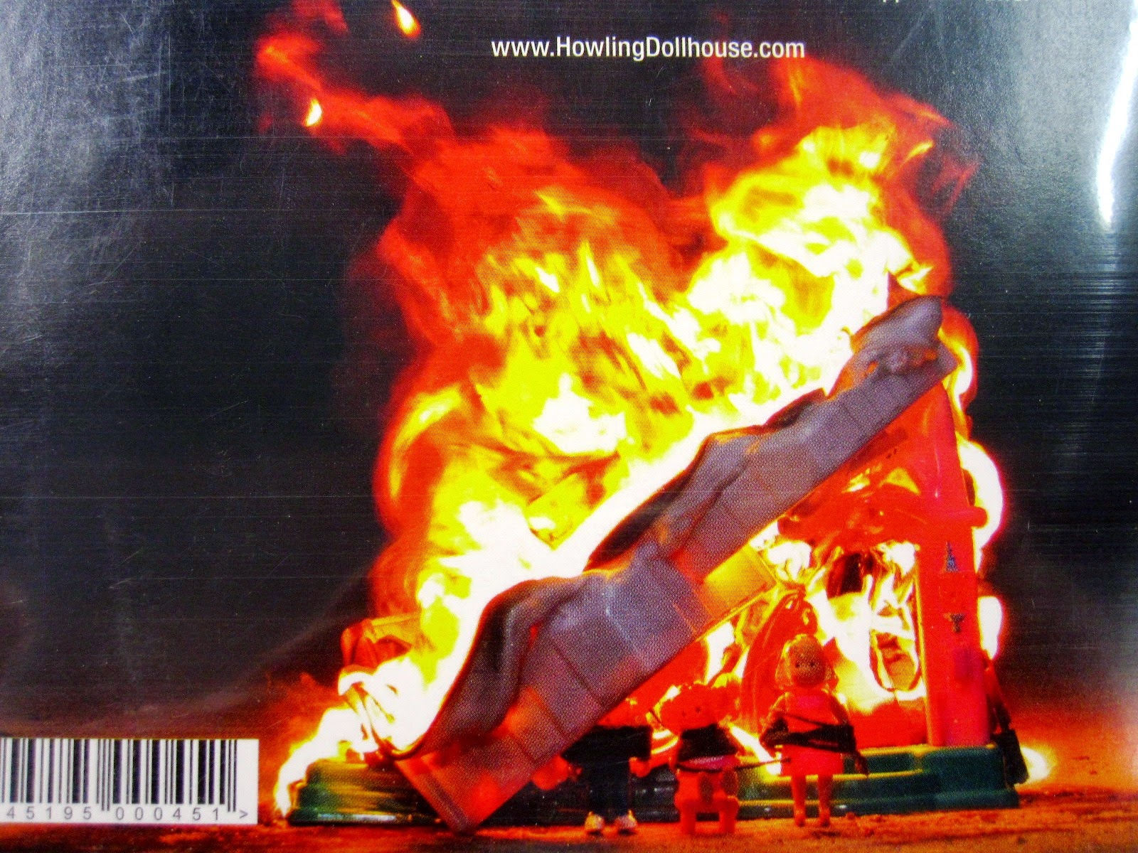 Back of a CD, showing a picture of a burning Fisher Price dollhouse.
