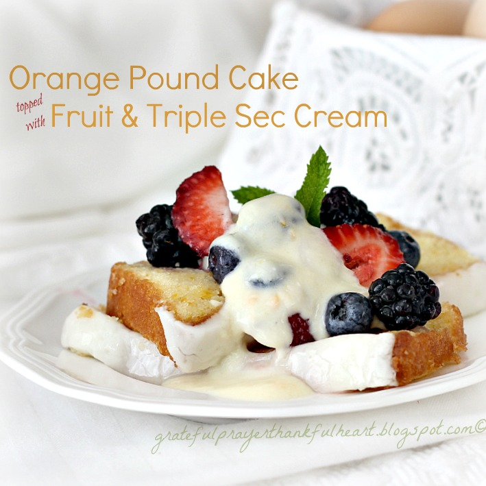 The orange pound cake with glazed top and light frosting stands alone ...