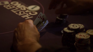 Jerry rechecks his cards during a hand in the second episode of HBO's 'Luck'