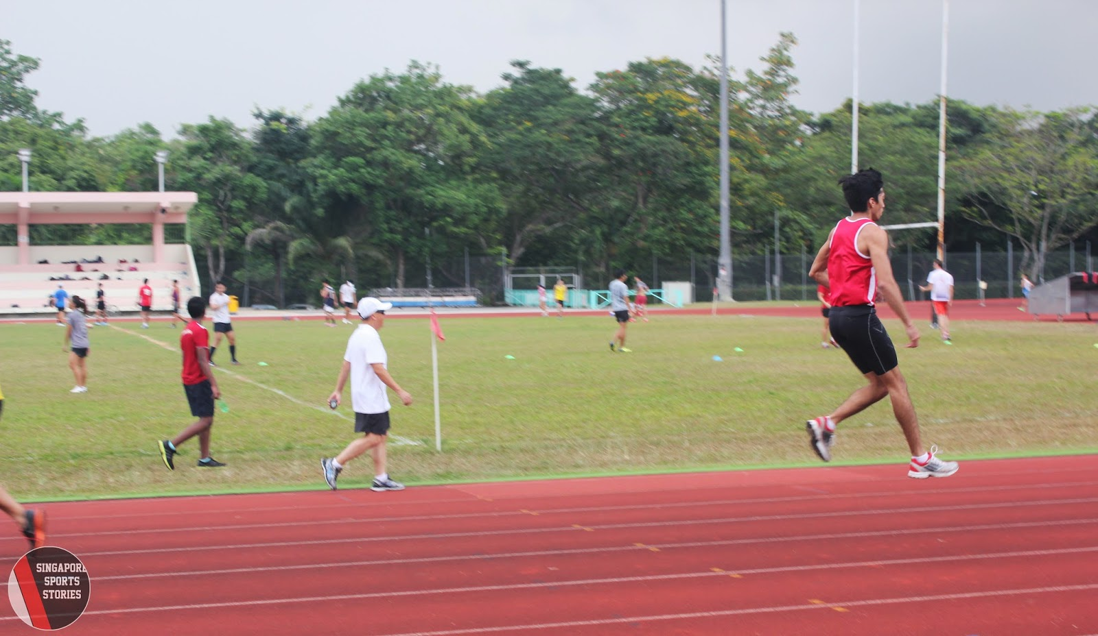 Khann Meng Linn warming up before long jump practice