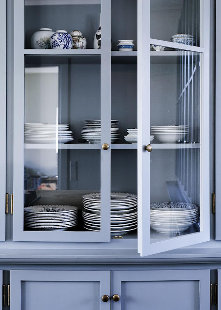 close up of kitchenware in the blue cabinets