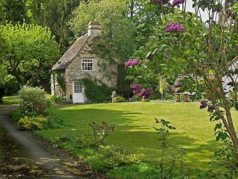 English Stone Cottage stone cottage with lilacs | content in a cottage