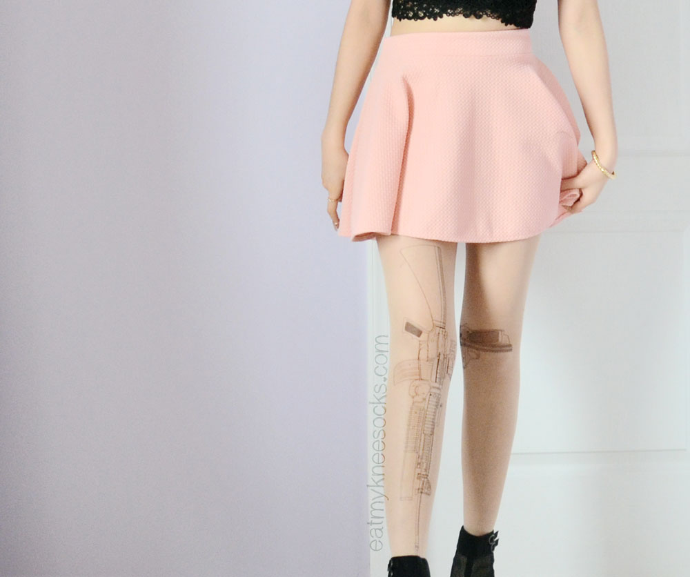 More photos of the sheer gun-print tights from Brave Store.