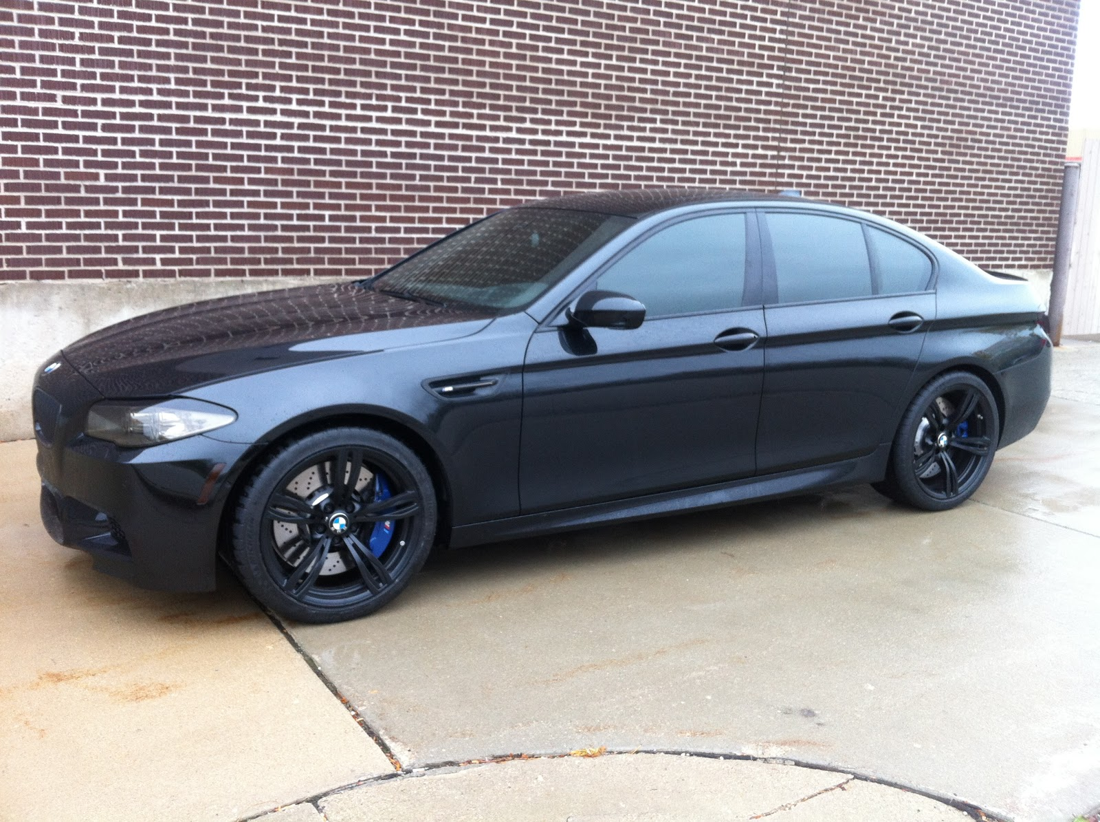bmw m5 2013 black. the stock m alloy wheels were powdercoated matte black. chrome door handle inserts and fender vents done in black carbon fiber. bmw m5 2013