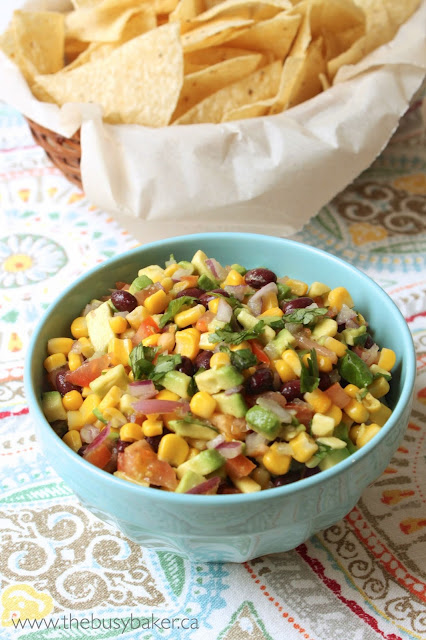 a bowl of fresh salsa with black beans, corn, and avocado