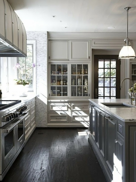 beautiful traditional black and white kitchen with white marble counter island light taupe gray painted panelled cabinets with glass