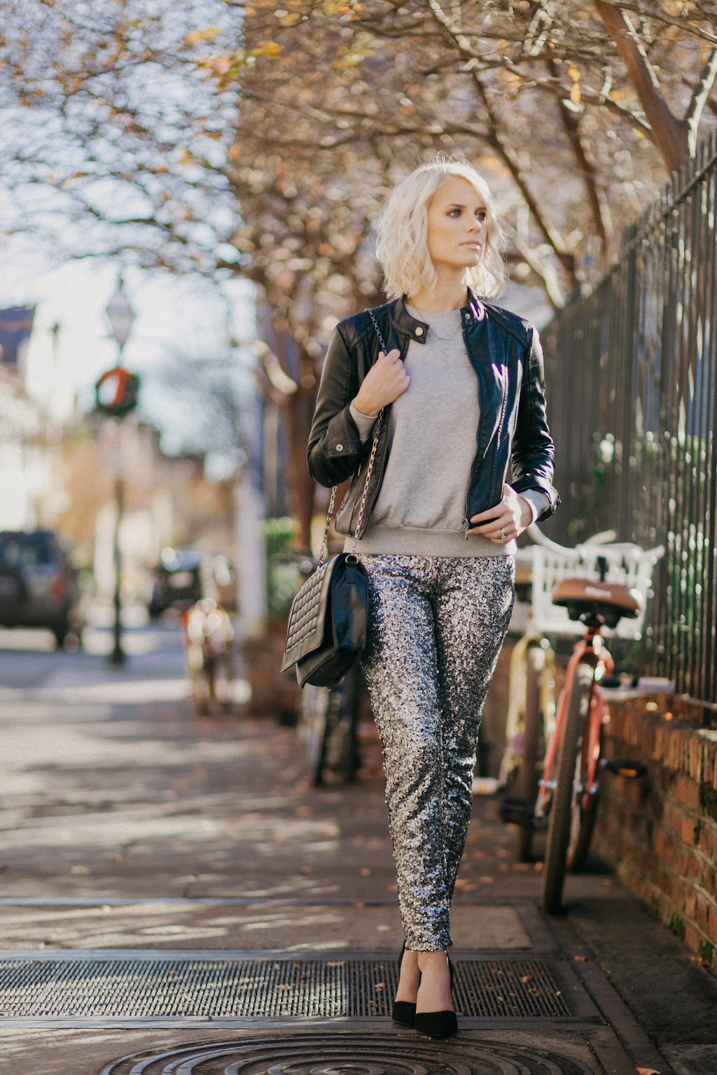 long bob platinum tousled hair blonde leather jacket fitted forever 21 inexpensive cheap budget 10 dollar grey comfy sweatshirt h&M hm silver sequin pants leggings Christmas Holiday looks party black quilted purse bag handbag clutch sideways gold cross necklace black suede d'orsay pumps heels stilettos steve madden varsity downtown charleston street style sc south carolina fashion blogger dannon k collard like the yogurt