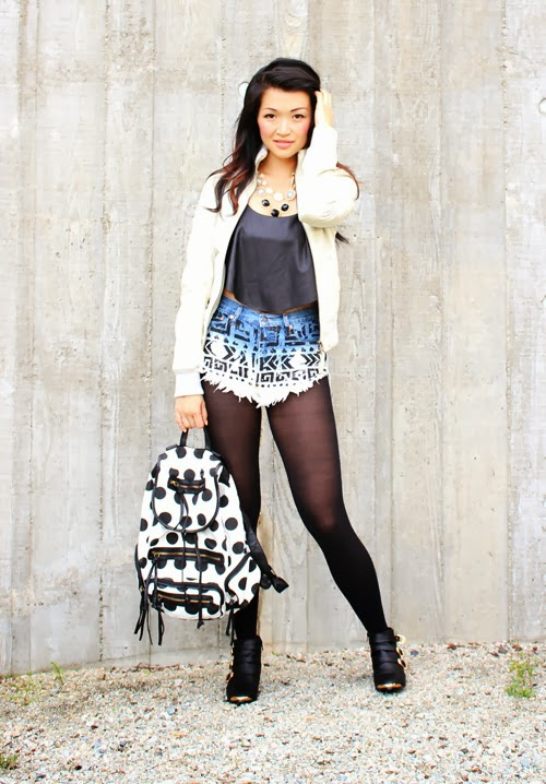 posing in vintage vancouver fashion blog jasmine zhu wearing mackage leather jacket, necessary clothing polka dot backpack, necessary clothing aztec shorts, necessary clothing crop top, necessary clothing buckle boots, street style