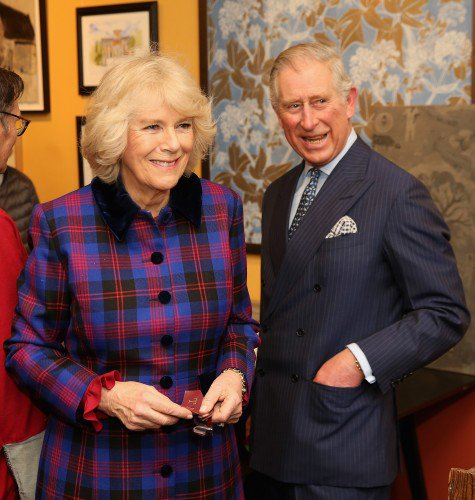 Camilla, Duchess of Cornwall is guided through St. Bride's Church