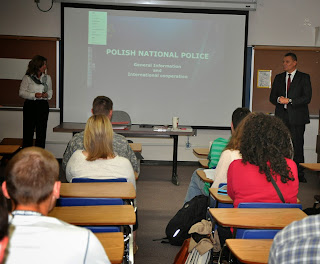 Gen. Schossler (r) discussed human trafficking in Dr. Magdalena Denham's (l)class.