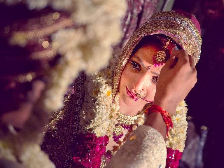 Sindoor or vermillion in dulhan (bride's) maang
