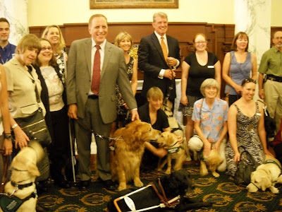 Acting CEO Morgan Watkins with Golden Guide Dog Will, Governor Otter and a crowd of GDB alumni, puppy raisers, donors and supporters of GDB and ICBVI
