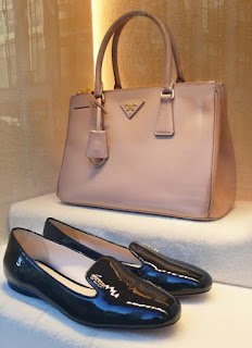 Prada Pink Saffiano Leather Classic handbag and patent leather slippers.