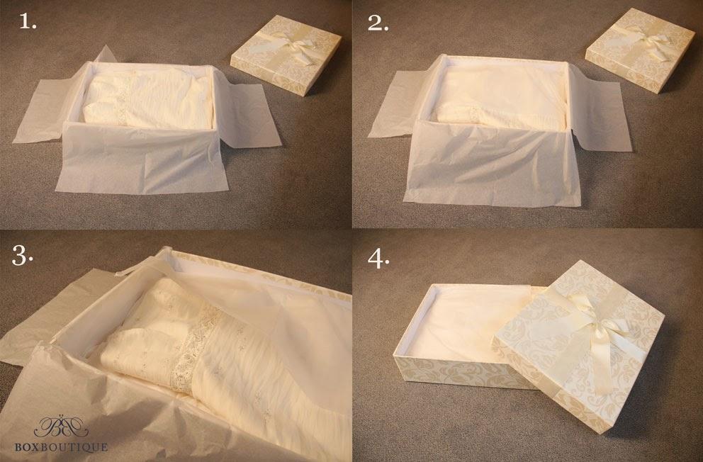 Schlagen Sie das Oberteil über den zusammengelegten Rock ein und bedecken Sie alles mit Seidenpapier.
