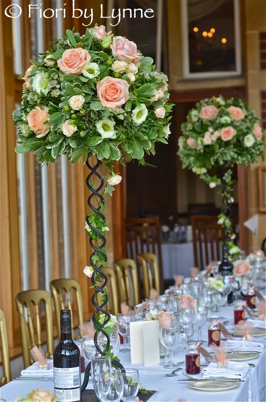 Trailing, top table design with candles using Pearl Avalanche roses, pale  apricot spray roses, white freesia and astrantia, pale green lisianthus, ...