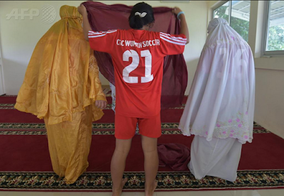 See Photo Of How Iranian Women Coverup Themselves Before Playing Football