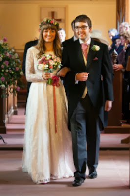 Real vintage bride Olivia in 1960s lace vintage wedding dress, Olivia and Nick walking up church aisle