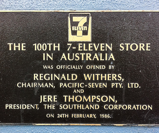 plaque signifying 100th seven eleven store in australia