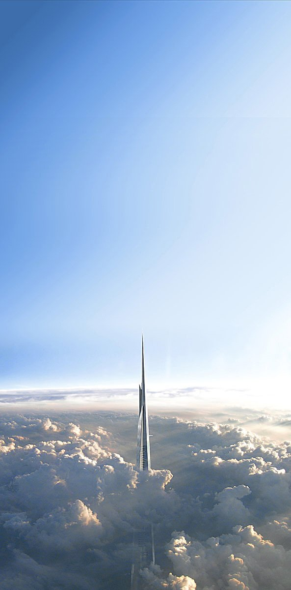 Photo of Kingdom Tower rising through the clouds